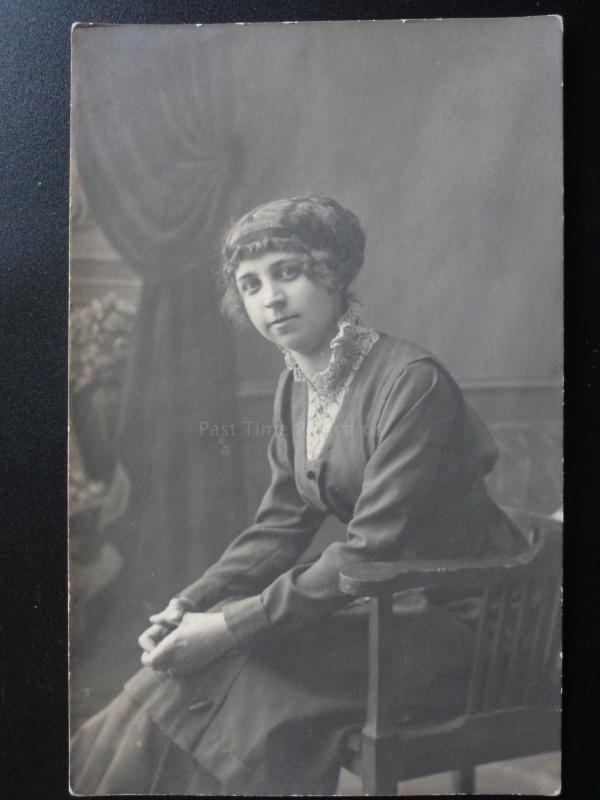 Studio Portrait: Women sitting in a chair c1916 Possibly Russian - RP Postcard