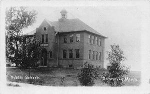 H57/ Donnelly Minnesota RPPC Postcard c1910 Public School Building  169