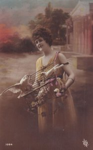 RP;  Woman carrying a cage full of Doves, 1900-10s