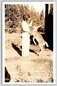 Ovando Montana~Little Girl Bottle Feeds Fawn~Hungry Baby Deer~1940s RPPC