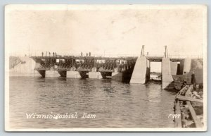 Deer River Minnesota~7 Men Standing Atop Winnibigoshish Dam~1920s RPPC