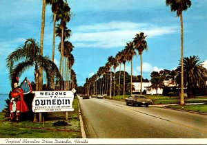 Florida Dunedin Welcome Sign Showing Shoreline Drive