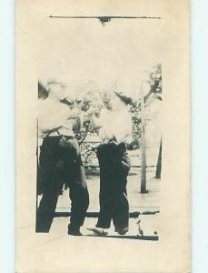 Pre-1929 rppc TWO MEN WITH HANDS UP FOR A FIST FIGHT r6588