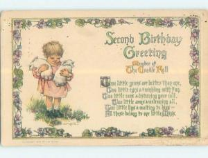 Pre-Linen signed CHILD CARRYING BABY RABBITS IN ARMS FOR SECOND BIRTHDAY HL4926