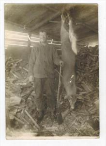 051  Deer Hunter Standing next to his trophy Deer Dinner