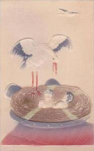 Stork With Baby In Nest
