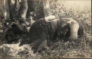 Escaped Prisoner?  Man on Ground Dead? McCabre? c1910 Unusual Bizarre RPPC