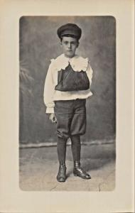YOUNG BOY WITH-BROKEN ARM? IN SLING-PERIOD CLOTHING REAL PHOTO POSTCARD