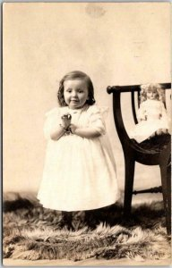 Vintage RPPC Studio Real Photo Postcard Happy Little Girl / Doll on Chair - 1915