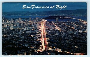 SAN FRANCISCO, CA California ~ View of DOWNTOWN at NIGHT c1950s  Postcard