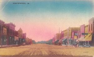 Northwood Iowa~Main Street~Grocer on Corner~Horse Wagons~Handcolored~1908 PC