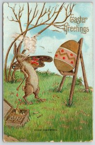 Easter Fantasy~Artist Rabbit Steps Back to Admire Work~Egg on Easel~Gold Emboss