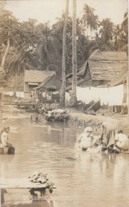 RP: PHILIPPINES , 00-10s ; Women doing Laundry in River