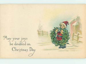 Pre-Linen christmas GIRL DRESSED IN SANTA COSTUME CARRYING WREATH hr2879