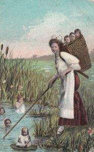 Woman carrying basket full of babies, Babies in eh marsh, 1900-10s