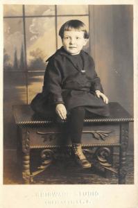 Uhrichsville Ohio~Grigware Studio RPPC~Kid of the Cloth? Bowl Haircut~Desk 1920s