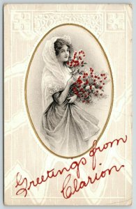 Greetings from Clarion Iowa~Demure Pretty Lady Holds Bouquet~1911 AA 685/3