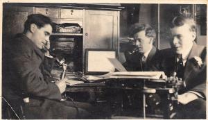Man Types in Messy Office~Typewriter~Fellow on Candlestick Telephone~1918 RPPC