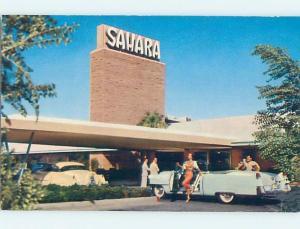 Pre-1980 RISQUE SEXY GIRL IN CAR AT SAHARA CASINO HOTEL Las Vegas NV B0459