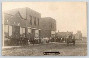 Hanlontown IA Crowd @ Drugstore~Men w/Flute Case* & White Dog~Elevator~RPPC 1910