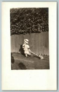 RPPC Momma, Am I Supposed to Pull This Toy or Push It? Toddler w/Bonnet~c1910