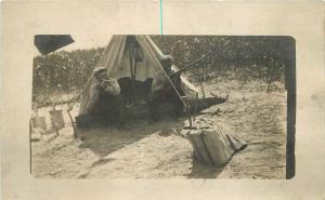 C-1910 Camping outdoor life men hunting rifles RPPC Tent real photo postcard 272