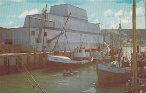 Riviere au Renard (Fox Rover) Diggers unloading catch at modern fish processi...