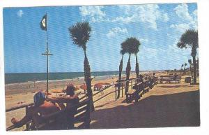 Enjoying the cool breezes and beautiful view along Myrtle Beach, South Caroli...