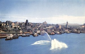 ​SEATTLE, WASHINGTON, fireboat, skyline, spay, buildings, storehouse, bay