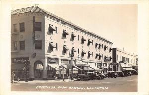Hanford CA Street View Storefronts Whilton Hotel Old Cars RPPC Postcard