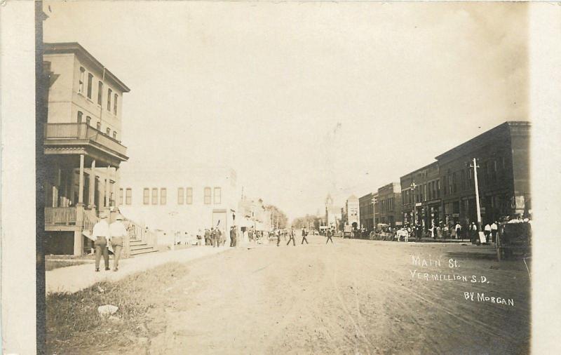 Vermilion SD Main Street~Hotel w/Balcony~Belltower~Pedestrians Sepia RPPC c1915
