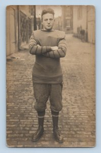 Early 1900s American Football Player Arms Crossed on Brick Road Sepia RPPC