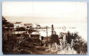 1936 RPPC UNION POSTMARK WATERFRONT SCENE DOCK PIER BOATS FISHING VILLAGE