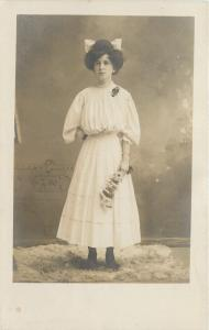 Lovely Lady~White Dress~White Bow In Hair~Holding Flowers~1908 Real Photo~RPPC