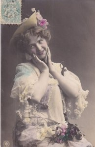 RP; Portrait of embarrased woung lady wearing hat with flowers, 1900-10s