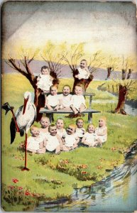 RARE - GROUP OF BABIES BY RIVER - STORK ANTIQUE POSTCARD - VINTAGE POSTED