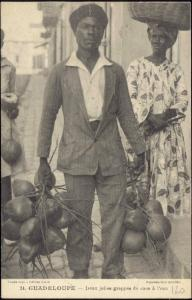 guadeloupe, Native Man with Bunches of Coconut (1931)