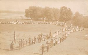 Patriotic Gathering~Crowd Forms 2 Lines~Uncle Sam w/ Flag~Band~Signs~c1918 RPPC