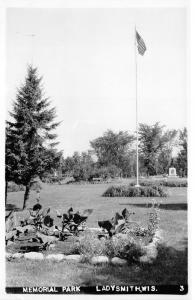 Ladysmith Wisconsin~Memorial Park~Monument~Old Glory Flying~Garden~Vintage RPPC