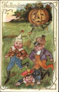 Halloween - Children Run From JOL Man c1910 Postcard EXC COND
