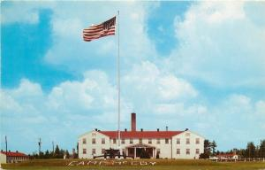 Camp McCoy Wisconsin~Army Post Headquarters~Flag~Cannon~1950s Postcard