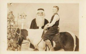 RP: Santa Claus & boy on horse, 1920-30s