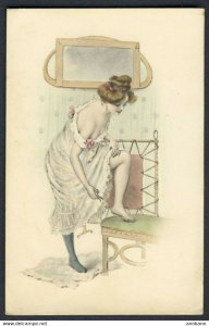 Partially nude woman with foot on chair & clippers in hand - unsigned Vienne