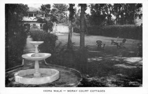 St Petersburg FL~Moray Court Cottages~Ixora Walk~Lawn Chairs~Fountain~1950s B&W