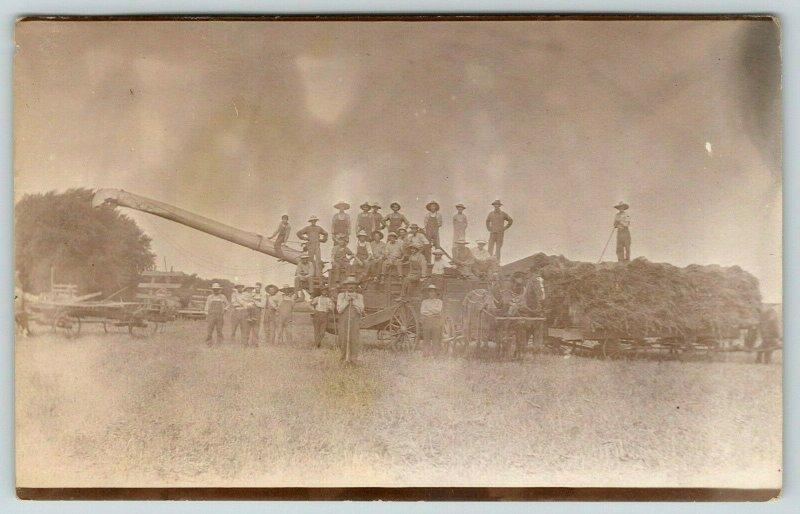 Real Photo Postcard~Farmers & Workers on Threshing Machine~Wagon~Pitchforks~1912