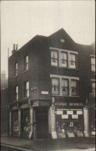 George Newbery Store BALHAM LONDON? Gilbey's Wine Signs c1910 RPPC