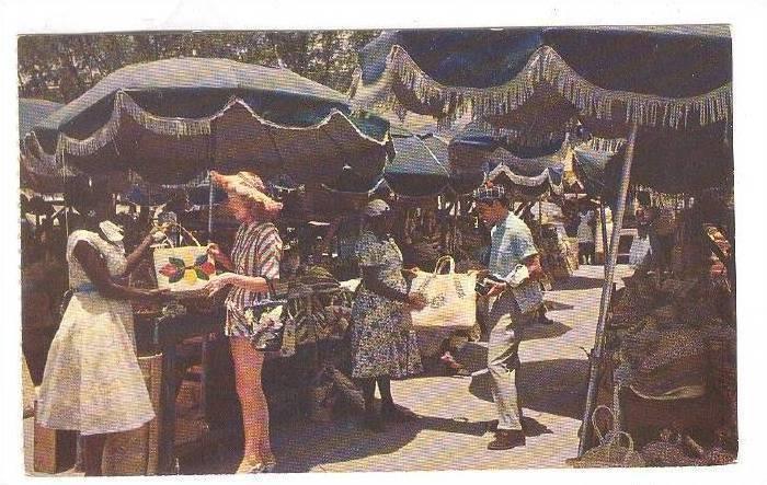 Tourists shopping at Nassau's famous Rawson Square Straw Market, Nassau, Ba...