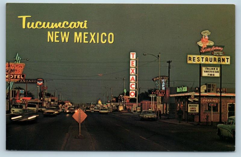 Postcard NM Tucumcari Route 66 at Night Texaco Standard Gas Stations c1950s O02