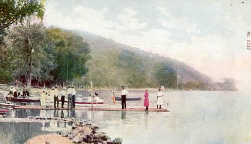 People Standing on Wharf & Riding in Boats- Unknown Location