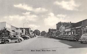 West Bend Iowa~Main Street~Ford Dealer~Drug Store~1940s Cars~B&W Curt Teich~PC